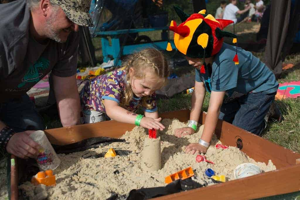 Children playing in a sandpit at Nozstock festival