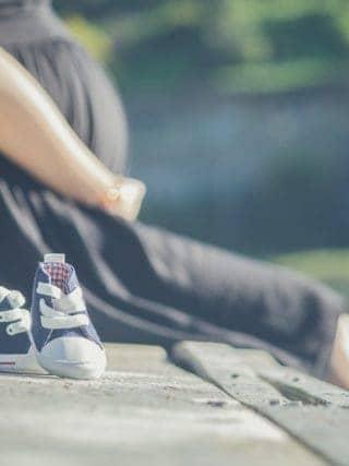 Pregnant lady sitting on wall