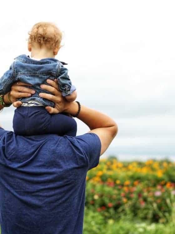 Baby on man's shoulders