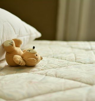 Mattress with teddy bear