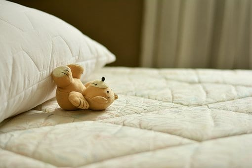 Mattress with teddy bear