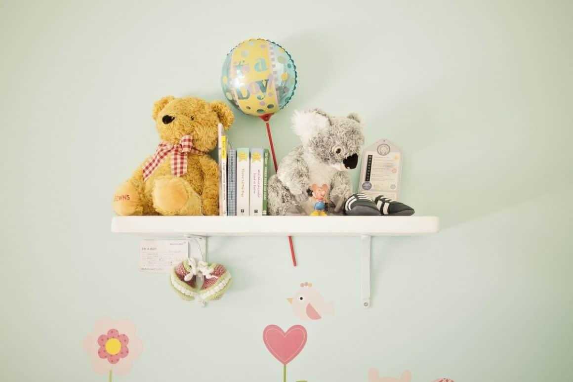 Toys on a nursery shelf