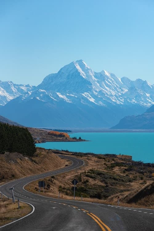 Road by water and mountains