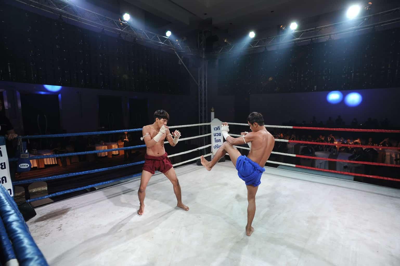 photo of two men Muay Thai fighting